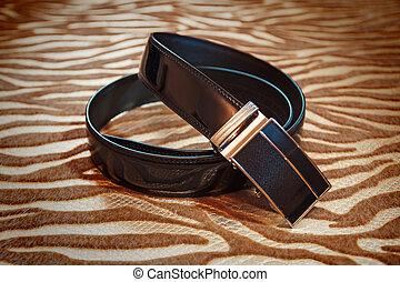 Wedding men's belt lying on the floor
