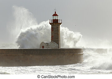 Stormy waves over lighthouse and pier with interesting...