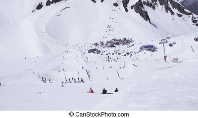 Ski resort. Snowboarders and skiers. Encamp. Ski lifts....