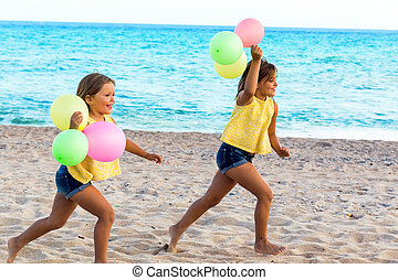 Two kids running on beach with color balloons. - Action...