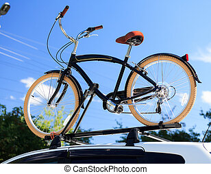 Bike transportation - bike on the roof of a car