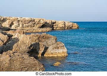 Sea coast, rocky bay in a quiet sunny day Mediterranean Sea,...