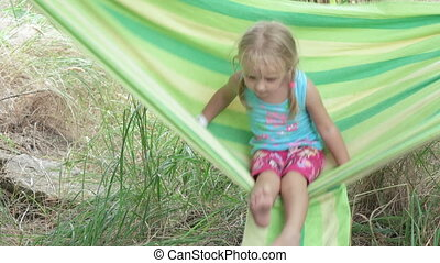 Little Girl in hammock - Child riding in hammock on nature