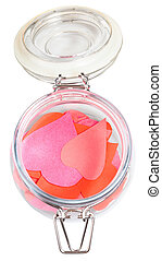 top view of many hearts cut out from paper in jar - top view...