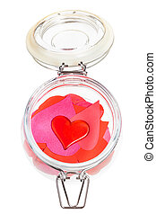 one red heart on pile of hearts in open jar - top view of...