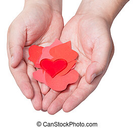 red heart above pile of paper hearts on male palms - one red...