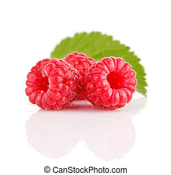 fresh raspberry fruits with green leaves
