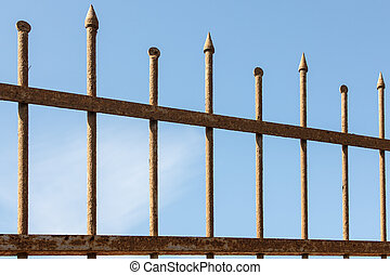fragment of metal fence