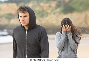 Teenager couple breaking up. The angry boyfriend leaves his...
