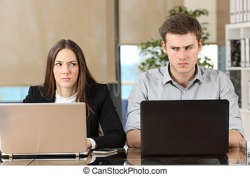 Two angry businesspeople disputing - Front view of two angry...