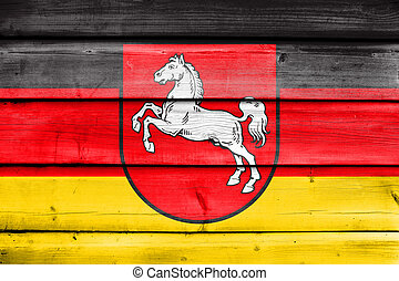 Flag of Lower Saxony, Germany, painted on old wood plank...