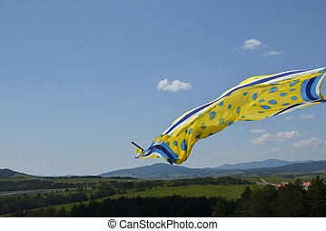 Scarf Waving in the Wind - Yellow and blue scarf waving in...