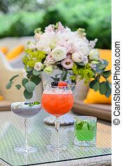 Glasses of cocktails on restaurant background