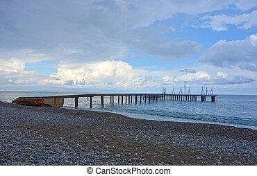 Pontoon bridge to the sea - Pebble beach with pontoon bridge...