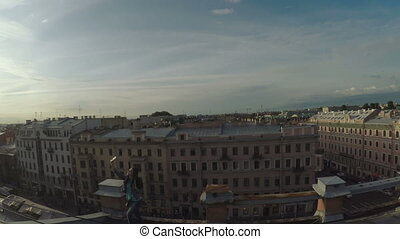 Girl photographs on old roof - RUSSIA, SAINT PETERSBURG,...