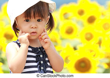 Japanese girl and sunflower field 1 year old