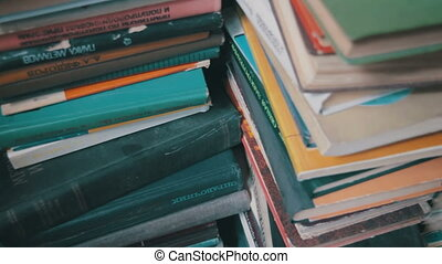 Stack of Books in the Library - A stack of old books in the...
