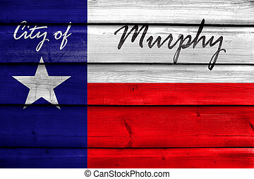 Flag of Murphy, Texas, USA, painted on old wood plank background