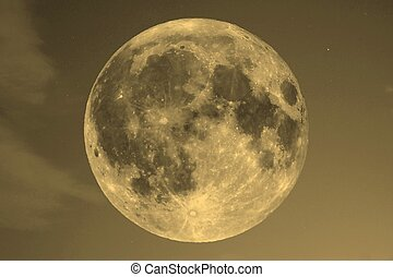 Full moon over blue sky sepia - Full moon seen with an...