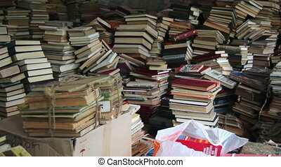 Pile of Books Scattered on the Floor in the Library A stack...
