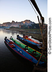Parking boats - Travel boats parking beside bamboo bridge at...