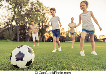 Family playing soccer - Low angle view of happy family is...