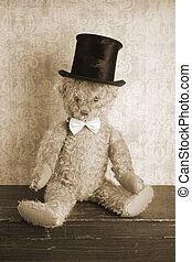 Vintage Teddy bear with top hat and bow tie, sepia tone