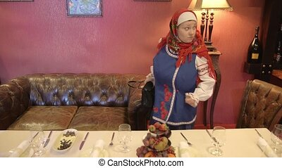 Woman in red shawl on head, Russian traditional clothes...