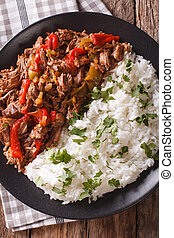 Latin American cuisine: ropa vieja with rice close-up....
