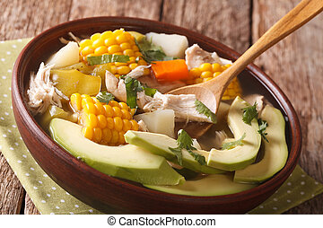 South American cuisine ajiaco soup close up in a bowl....