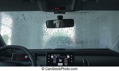 Car wash with pressured water at service station. Automatic...
