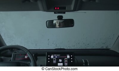 Car running through automatic car wash - View from car...