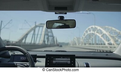 Driving car on the bridge in the city. View inside out