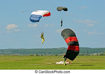 Skydiver landed after the jump - Paraglider landed after the...