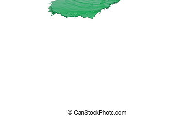 green liquid pouring on white background. Colored paint -...