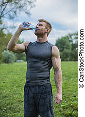 Drinking water - Athletic sport man drinking water from a...