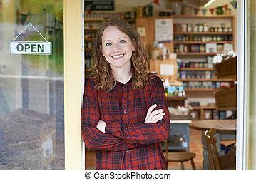 Portrait Of Female Delicatessen Owner Outside Store
