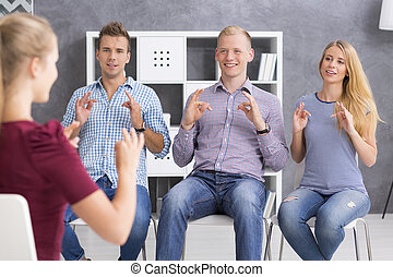 Beautiful langauge is a sign language - Group of young...
