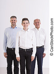 Happy family standing together - Shot of an elegant young...