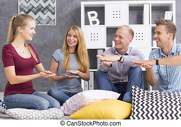 Sign language for beginners - Group of young people studying...