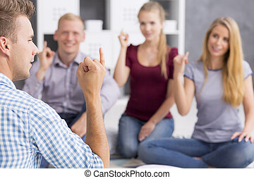 Can you see what i mean? - Man teaching a sign language,...