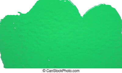 green drops falling on white screen. Colored paint