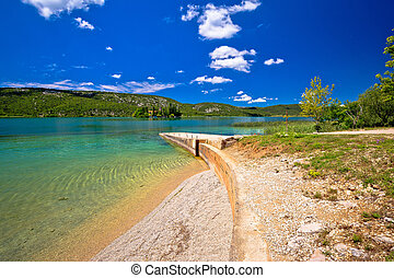 Visovac lake beach in Krka river national park, Dalmatia,...