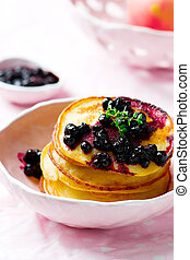 Cornmeal pancakes with blueberry sauce vintage style...