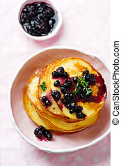 Cornmeal pancakes with blueberry sauce .vintage style...