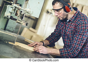 Carpenter at work - Close up of a young carpenter at work.He...