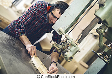 Carpentry workshop - Close up of a young carpenter at...