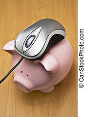 Online banking - Metallic color computer mouse on top of a...