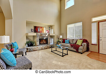Cozy luxury family room with high ceiling and entryway....