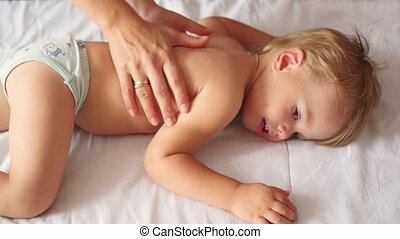 the child is doing back massage - the child is doing firming...